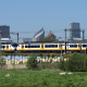 Train in front of The Hague skyline