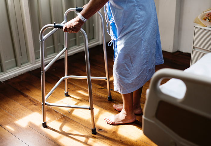 Man with Zimmer frame in hospital