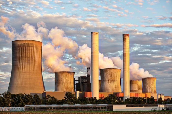 Industrial cooling towers. Photo by JuergenPM on Pexels.